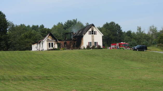 The burned out home at 183 Boyce Road, Schodack, on Saturday, Aug. 25, 2012. (Bob Gardinier/Times Union)