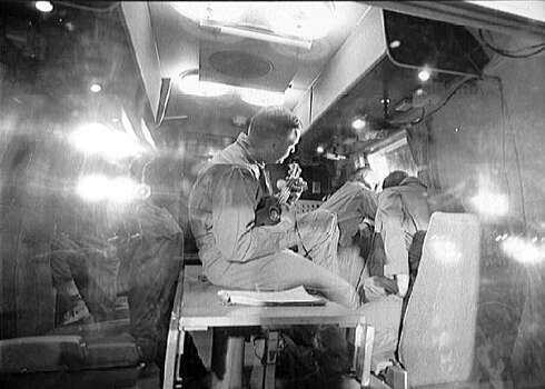 Neil Armstrong plays the ukulele while his fellow Apollo 11 crewmembers, Edwin 'Buzz' Aldrin, Jr. and Michael Collins look through a window of their quarantine chamber at Ellington Air Force Base on July 27, 1969, after their return to earth. The 30th anniversary of Apollo 11's historic mission where Armstrong became the first man to set foot on the moon will be next week on July 20, 1999. Photo: NASA, NYT / NASA