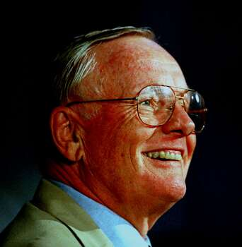 Neil Armstrong, the first man to set foot on the moon, flashes a familiar smile as he answers questions at a news conference at Kennedy Space Center, Fla. Friday, July 16, 1999. Armstrong is at the center celebrating the 30th anniversary of the Apollo 11 launch. Photo: PETER COSGROVE, AP / AP