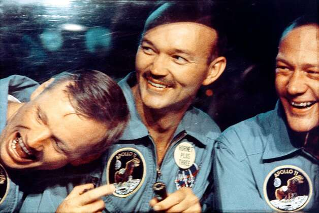 "ThinkFilm provided this photo of (left to right) Neil Armstrong, Mike Collins and Buzz Aldrin after the July, 1969 Apollo 11 mission from ""In the Shadow of the Moon."" Photo: AP / ThinkFilm"