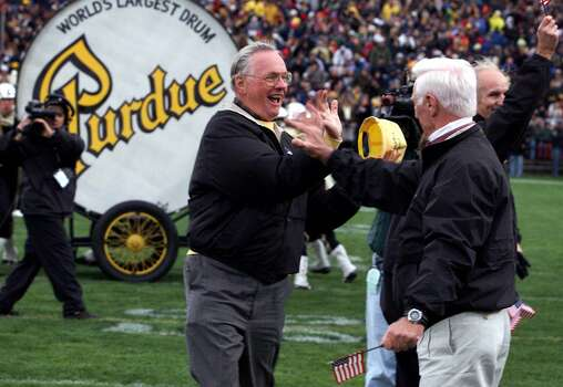 Neil Armstrong, center, high-fives fellow Apollo astronaut Eugene Cernan after Armstrong banged the Purdue drum during halftime ceremonies of the Purdue-Penn State game, Saturday, Oct. 23, 1999, in West Lafayette, Ind. The festivities honored 18 astronauts who graduated from Purdue. Photo: FRANK OLIVER, AP / JOURNAL AND COURIER