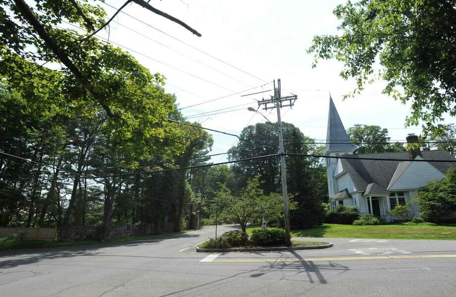 The area to the left of the intersection of Riversville Road, left, and John Street, foreground right, in Greenwich, Saturday, Aug. 25, 2012. This location is one of the potential sites for the northwest Greenwich fire station. At right, on the southwestern corner of Riversville Road and John Street is the North Greenwich Congregational Church. Photo: Bob Luckey / Greenwich Time