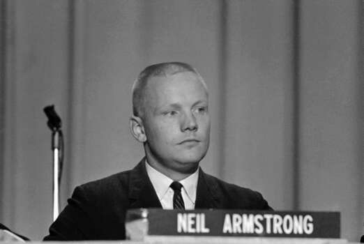 """In this Sept. 17, 1962 file photo, Neil Armstrong, one of the nine astronauts, is shown as he was introduced to the press, along with the other astronauts in Houston. The family of Neil Armstrong, the first man to walk on the moon, says he has died at age 82. A statement from the family says he died following complications resulting from cardiovascular procedures. It doesn't say where he died. Armstrong commanded the Apollo 11 spacecraft that landed on the moon July 20, 1969. He radioed back to Earth the historic news of """"one giant leap for mankind."""" Armstrong and fellow astronaut Edwin """"Buzz"""" Aldrin spent nearly three hours walking on the moon, collecting samples, conducting experiments and taking photographs. In all, 12 Americans walked on the moon from 1969 to 1972. Photo: Anonymous, Associated Press / AP"""