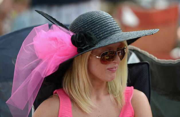 Lindsey Montayne of Queensbury shows offer beautiful hat on Travers Day at the Saratoga Race Course  in Saratoga Springs, N.Y. Aug. 25, 2012.   (Skip Dickstein/Times Union) Photo: Skip Dickstein / 00019010A