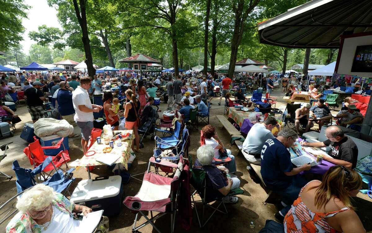 There is very little real estate to be seen in the picnic area on Travers Day at the Saratoga Race Course in Saratoga Springs, N.Y. Aug. 25, 2012. (Skip Dickstein/Times Union)