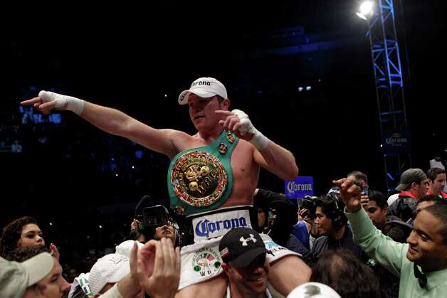 "Saul ""Canelo"" Alvarez, of Mexico, celebrates after beating Kermit Cintron, from Puerto Rico, during a WBC light middleweight championship boxing bout in Mexico City, Saturday, Nov. 26, 2011.(AP Photo/Dario Lopez-Mills) Photo: Dario Lopez-Mills, Associated Press / AP"