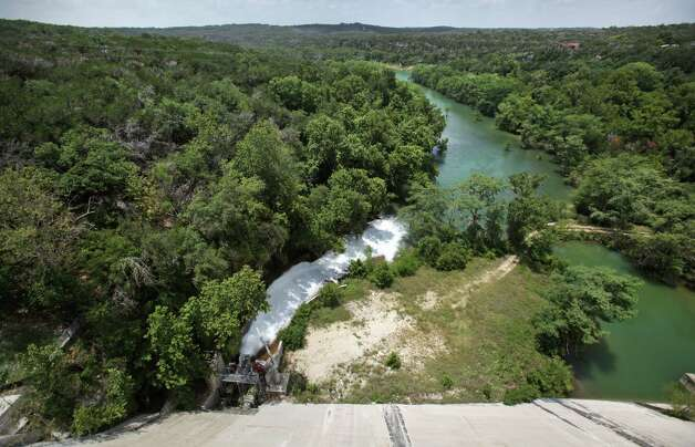 Water flows from the release valve at the base of Medina Lake Dam. The water is used by farmers down river. Monday, July 2, 2012. Photo: BOB OWEN, Express-News / © 2012 San Antonio Express-News