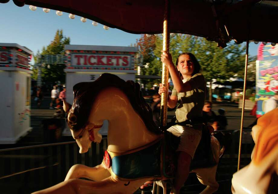 A girl rides the merry-go-round. Photo: Sofia Jaramillo / SEATTLEPI.COM