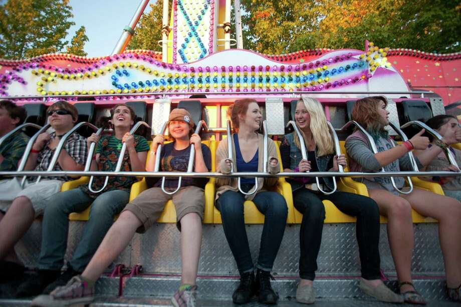 People smile after they finish riding an amusement ride. Photo: Sofia Jaramillo / SEATTLEPI.COM