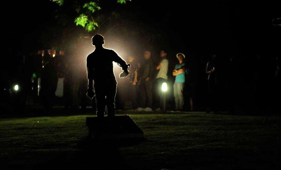 John Perez throws a beanbag. Photo: LINDSEY WASSON / SEATTLEPI.COM