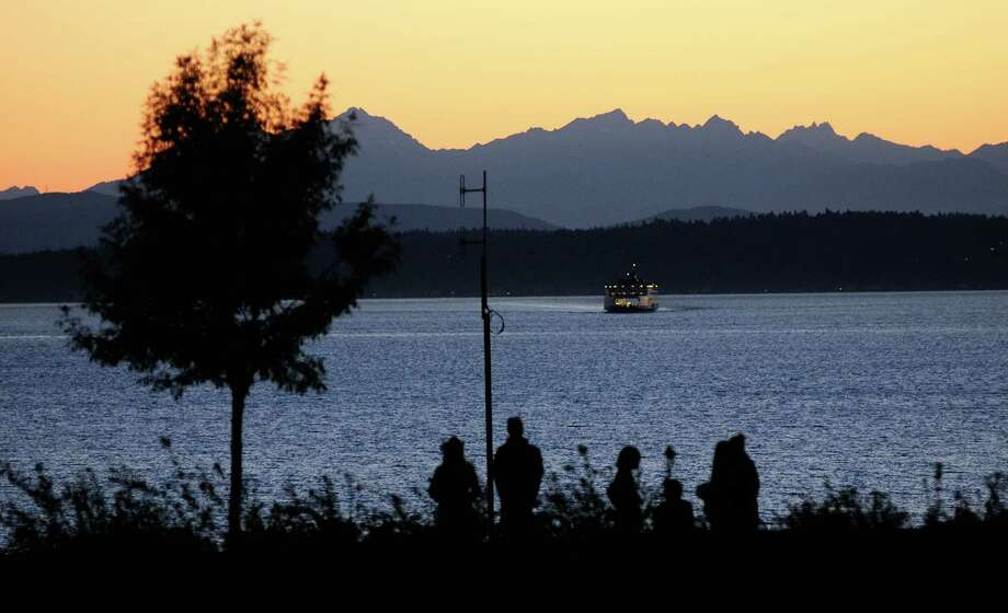 People watch the sunset as a ferry makes its way across the water. Photo: LINDSEY WASSON / SEATTLEPI.COM