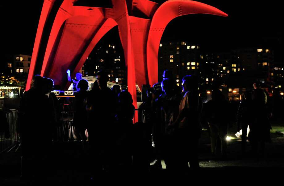 People dance on the path near Alexander Calder's Eagle as DJ Riz plays some tunes. Photo: LINDSEY WASSON / SEATTLEPI.COM