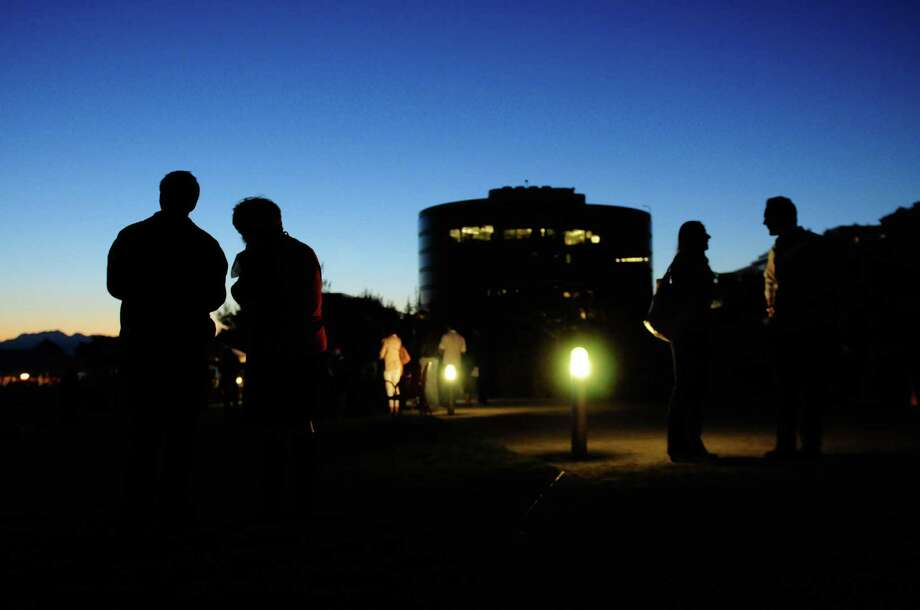 People are silhouetted against path lights. Photo: LINDSEY WASSON / SEATTLEPI.COM