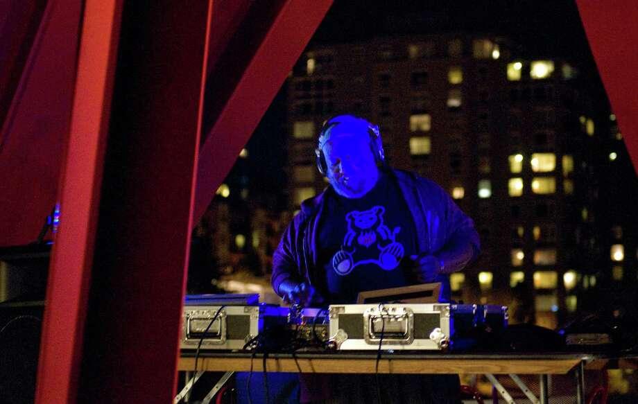 DJ Riz entertains attendees under Alexander Calder's Eagle. Photo: LINDSEY WASSON / SEATTLEPI.COM