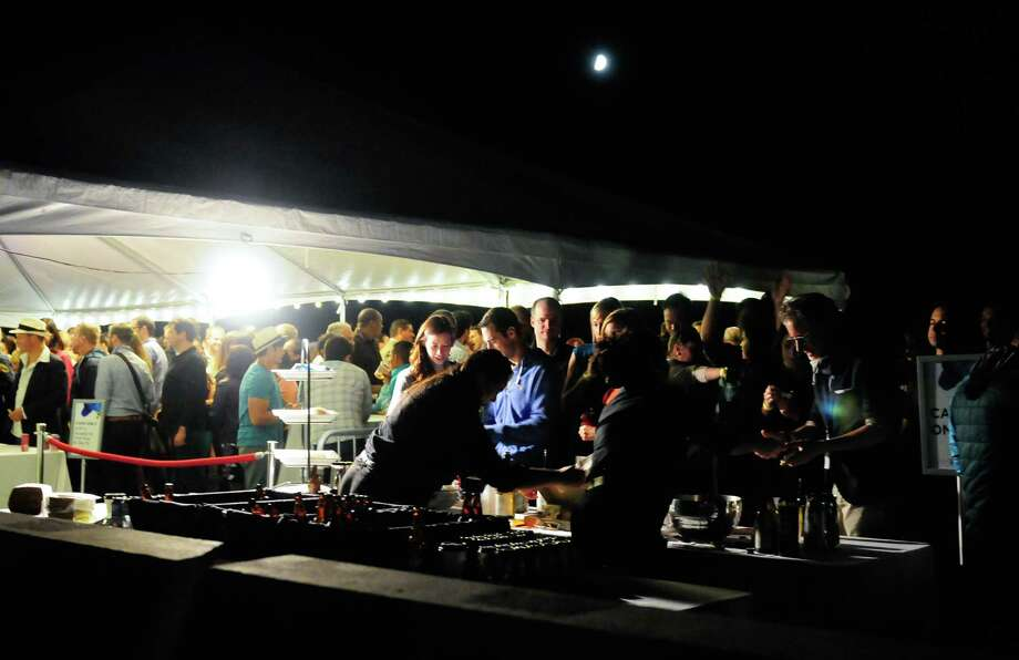 The moon shines down upon partygoers. Photo: LINDSEY WASSON / SEATTLEPI.COM
