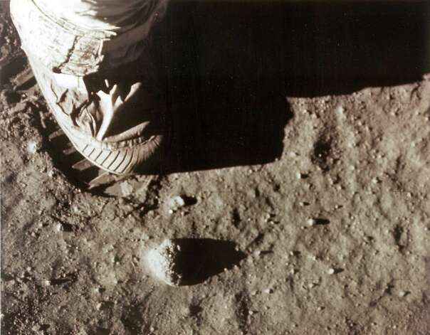 "In this photo from NASA, Apollo 11 commander Neil Armstrong's right foot leaves a footprint in the lunar soil July 20, 1969 as he and Edwin ""Buzz"" Aldrin become the first men to set foot on the surface of the moon. Armstrong, the first person to set foot on the moon, has died, US media reported Saturday. He was 82. Armstrong underwent cardiac bypass surgery, earlier this month after doctors found blockages in his coronary arteries. He and fellow Apollo 11 astronaut Buzz Aldrin landed on the moon on July 20, 1969, before the eyes of hundreds of millions of awed television viewers worldwide.  = RESTRICTED TO EDITORIAL USE - MANDATORY CREDIT ""AFP PHOTO / NASA"" - NO MARKETING NO ADVERTISING CAMPAIGNS - DISTRIBUTED AS A SERVICE TO CLIENTS =NASA/AFP/GettyImages Photo: NASA, AFP/Getty Images / AFP ImageForum"
