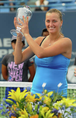 Petra Kvitova receives her trophy after winning the 2012 New Haven Open at Yale in New Haven, Conn. on Saturday August 25, 2012. Kvitova beat Maria Kirilenko 7-6 (9), 7-5. Photo: Christian Abraham / Connecticut Post