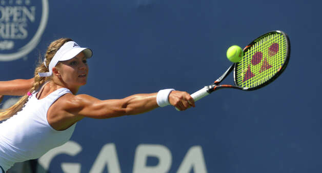 Maria Kirilenko strains in an attempt to return the ball to Petra Kvitova, during 2012 New Haven Open at Yale in New Haven, Conn. on Saturday August 25, 2012. Kvitova beat Kirilenko 7-6 (9), 7-5 to win the open. Photo: Christian Abraham / Connecticut Post
