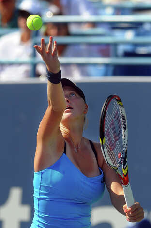Petra Kvitova releases the ball to serve it to her opponent Maria Kirilenko, during 2012 New Haven Open at Yale in New Haven, Conn. on Saturday August 25, 2012. Kvitova beat Kirilenko 7-6 (9), 7-5. Photo: Christian Abraham / Connecticut Post