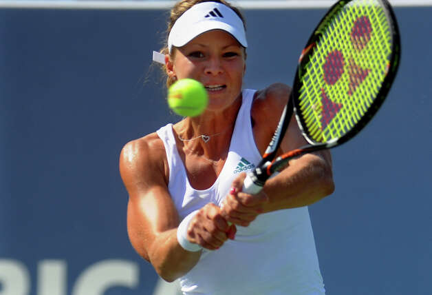 Maria Kirilenko returns the ball to her opponent Petra Kvitova, during 2012 New Haven Open at Yale in New Haven, Conn. on Saturday August 25, 2012. Kvitova beat Kirilenko 7-6 (9), 7-5. Photo: Christian Abraham / Connecticut Post