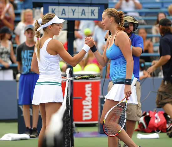Petra Kvitova, right, shakes hands with her opponent Maria Kirilenko after winning the 2012 New Haven Open at Yale in New Haven, Conn. on Saturday August 25, 2012. Kvitova beat Kirilenko 7-6 (9), 7-5. Photo: Christian Abraham / Connecticut Post