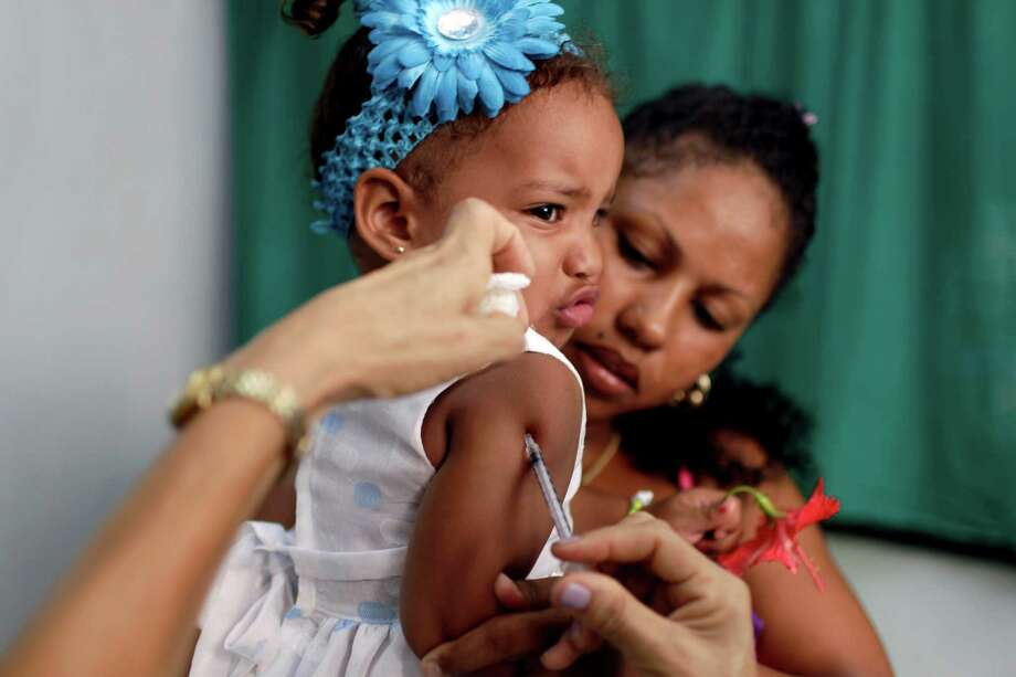 Karolin Deniss Verdecia gets a shot for allergies at a neighborhood clinic in Havana. Cuba's system of free medical care apparently is not immune to cutbacks. Photo: Franklin Reyes / AP