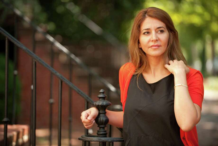 "Millions of Syrians once listened to Honey al-Sayed, host of the radio program ""Good Morning Syria."" Now she's a refugee, living in exile in Washington, D.C. Photo: MARY F. CALVERT / MCT"