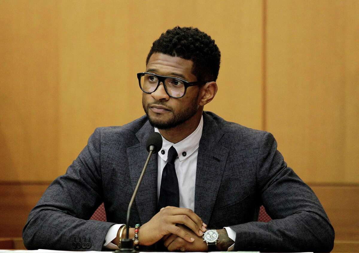FILE - In this May 22, 2012 file photo, hip-hop artist Usher Raymond takes the witness stand in court in a legal battle with his ex-wife in a custody fight involving their two sons, in Atlanta. Fulton County Court Clerk?'s office spokeswoman Cherrise Boone says a judge ruled Friday, Aug. 24, 2012 that the 33-year-old singer will have primary physical custody of Usher Raymond V and Naviyd Ely Raymond. (AP Photo/David Goldman, File)