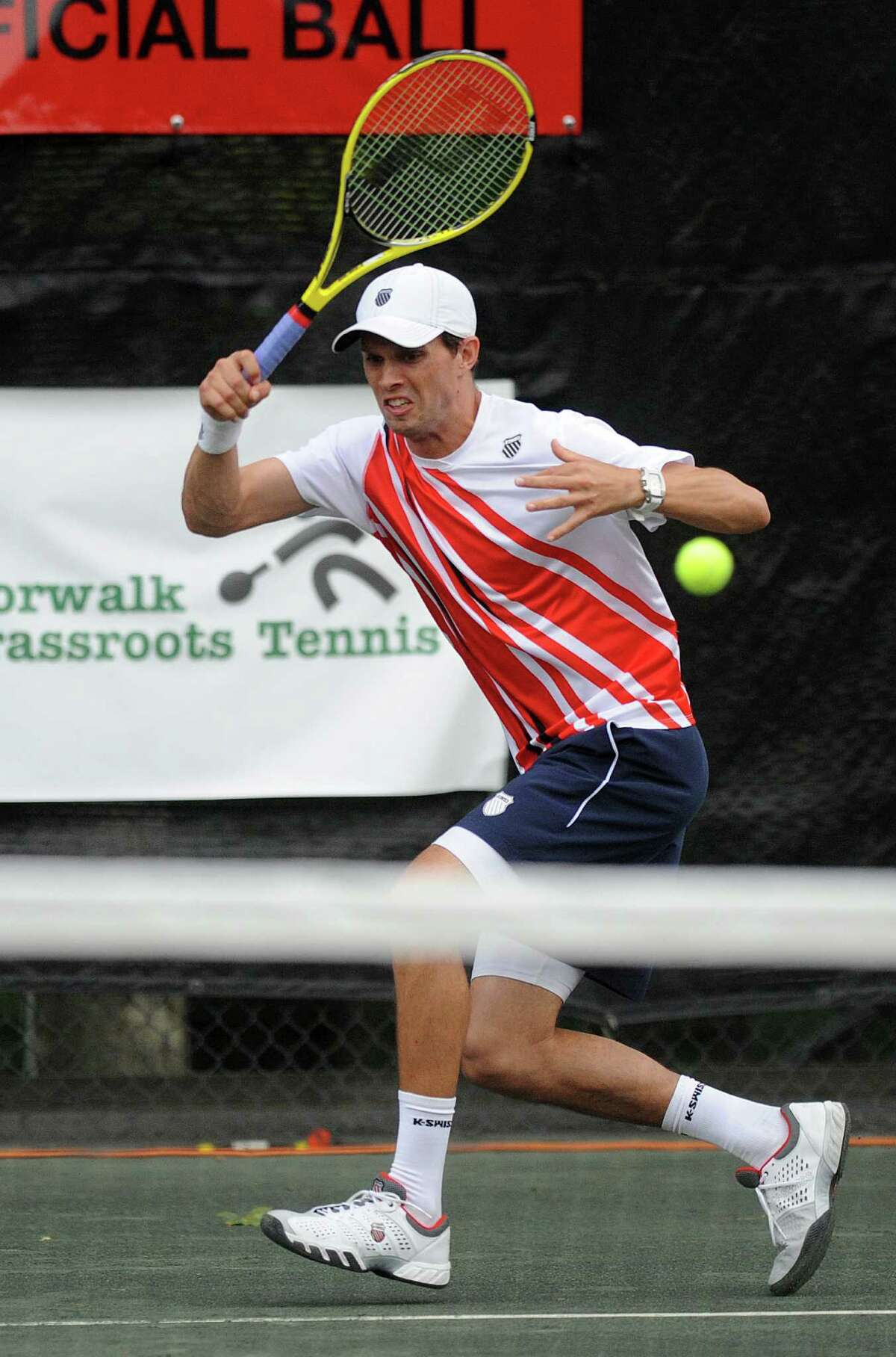 Olympic gold-medalist Mike Bryan plays alongside his twin brother, Bob Bryan, in a professional tennis exhibition at the Lake Club in Wilton, Conn., on Saturday, August 25, 2012.