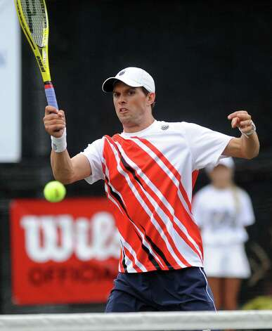Olympic gold-medalist Mike Bryan plays alongside his twin brother, Bob Bryan, in a professional tennis exhibition at the Lake Club in Wilton, Conn., on Saturday, August 25, 2012. Photo: Lindsay Niegelberg / Stamford Advocate