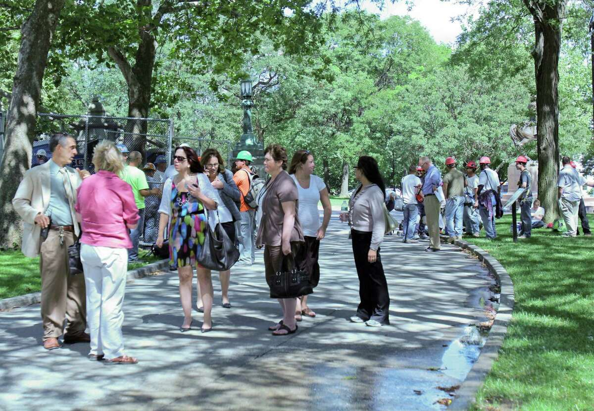 People stand outside of the Capitol building after an earthquake causes an evacuation of surrounding office buildings on Tuesday, Aug. 23, 2011. (Erin Colligan / Special To The Times Union)