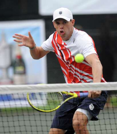 Olympic gold-medalist Bob Bryan plays alongside his twin brother, Mike, in a professional tennis exhibition at the Lake Club in Wilton, Conn., on Saturday, August 25, 2012. Photo: Lindsay Niegelberg / Stamford Advocate