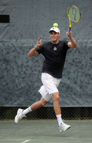Olympic gold-medalist Bob Bryan plays in a pro-am match before playing a professional tennis exhibition at the Lake Club in Wilton, Conn., on Saturday, August 25, 2012. Photo: Lindsay Niegelberg / Stamford Advocate