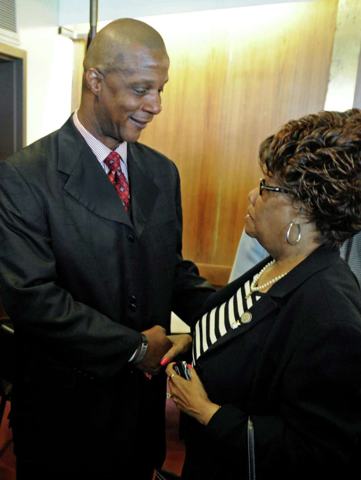FILE - In this May 11, 2010 file photo, New York state Sen. Shirley Huntley, D-Queens, greets former New York Mets and New York Yankees slugger Darryl Strawberry at a news conference in Albany, N.Y. Huntley says she expects to be arrested Monday, Aug. 27, 2012, amid a continuing investigation by Attorney General Eric Schneiderman into state grants she provided nonprofit organizations. (AP Photo/Tim Roske, File)