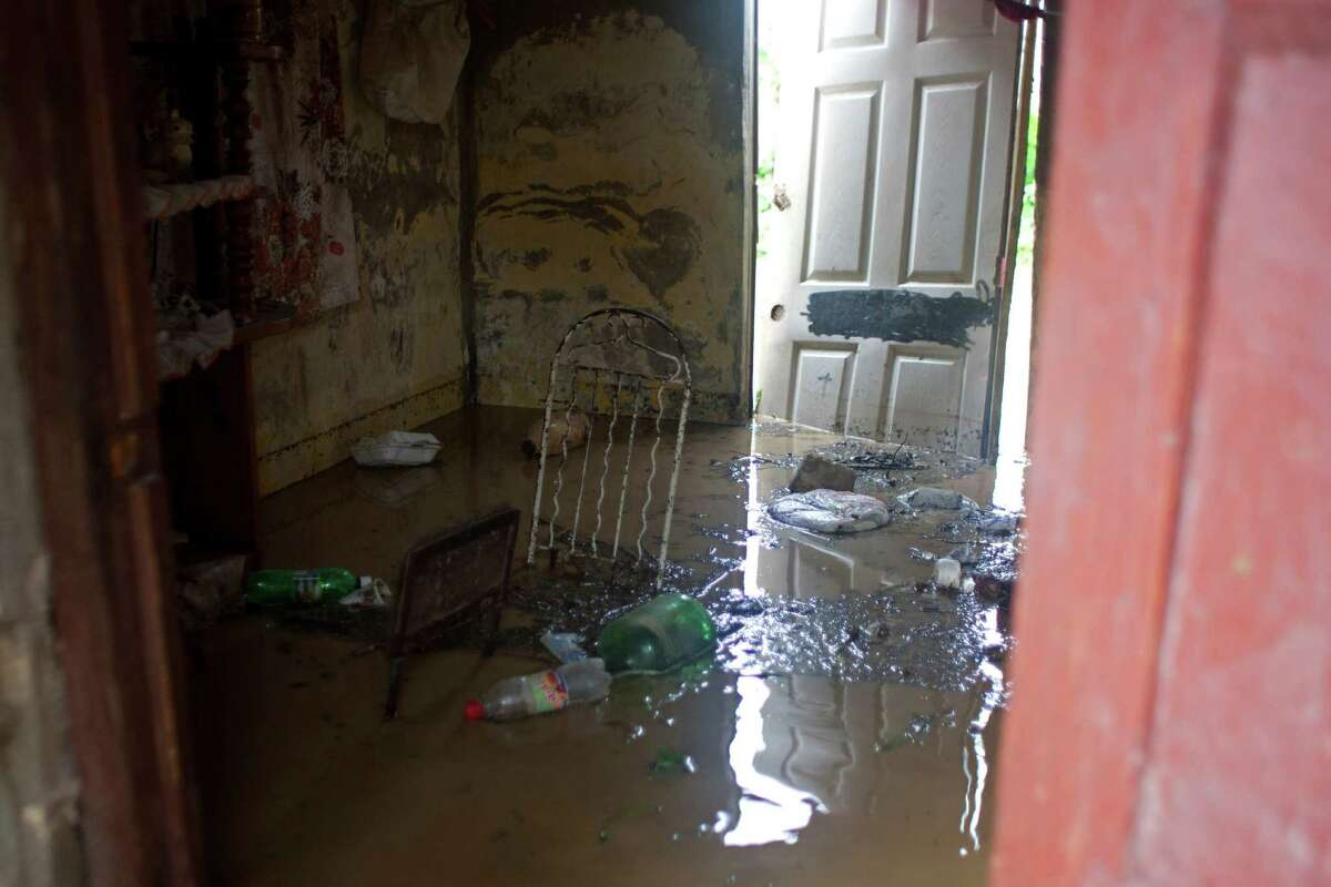 The interior of a home is filled with floodwater brought by Tropical Storm Isaac in Port-au-Prince, Haiti, Saturday, Aug. 25, 2012. Tropical Storm Isaac swept across Haiti's southern peninsula early Saturday, dousing a capital city prone to flooding and adding to the misery of a poor nation still trying to recover from the 2010 earthquake. (AP Photo/Dieu Nalio Chery)