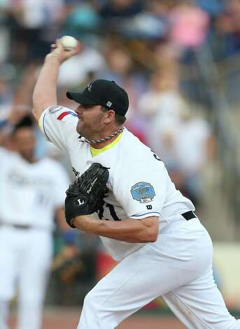 Roger Clemens pitches from the mound in the first inning of the Sugar Land Skeeters baseball game against Bridgeport at Constellation Field, Sunday, Aug. 26, 2012, in Sugar Land, where Roger Clemens was set to take the mound. Photo: Karen Warren, Houston Chronicle / © 2012  Houston Chronicle