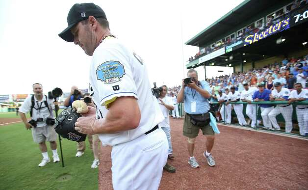 Roger Clemens goes out onto the field before the start of the Sugar Land Skeeters baseball game against Bridgeport at Constellation Field, Sunday, Aug. 26, 2012, in Sugar Land, where Roger Clemens was set to take the mound. Photo: Karen Warren, Houston Chronicle / © 2012  Houston Chronicle