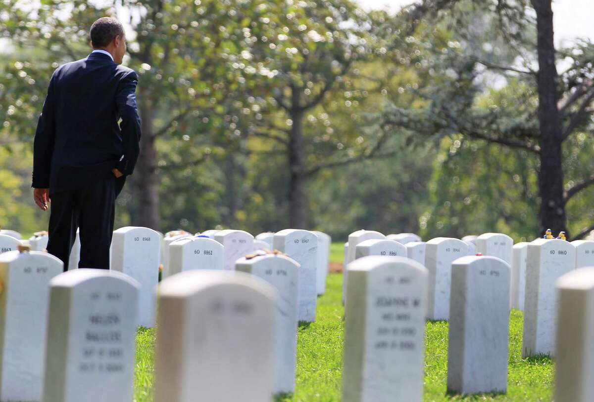 FILE - In this Saturday, Sept. 10, 2011 file photo, President Barack Obama looks out over graves in Section 60 at Arlington National Cemetery in Arlington, Va., where he paid his respects to those who have made the ultimate sacrifice in the past decade. It was once President Barack Obama's