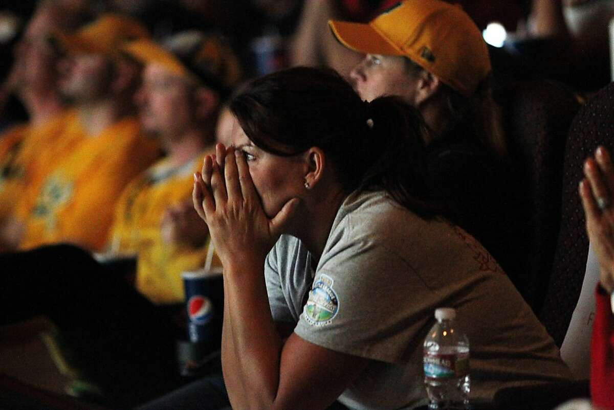 Tami Fribitas reacts as home team Petaluma Nationals falls behind during a live broadcast of the Little League World Series United States Championship between California against Tennessee at Boulevard 14 Cinema in Petaluma, Calif. on Saturday, Aug. 25, 2012. Tennessee defeated California 24-15.