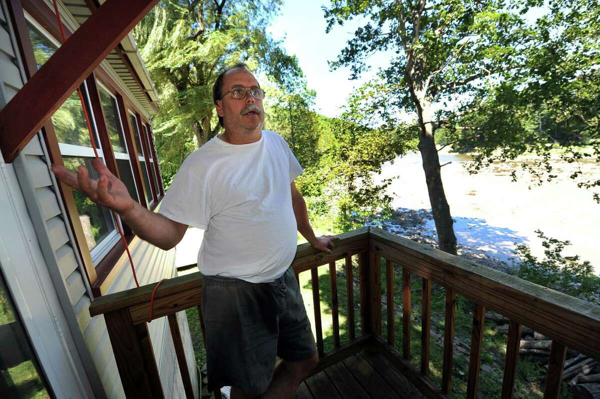 Mike Fogg on a balcony overlooking Schoharie Creek on Tuesday, Aug. 21, 2012, at his home in Esperance, N.Y. Fogg's repairing his home after Tropical Storm Irene. (Cindy Schultz / Times Union)