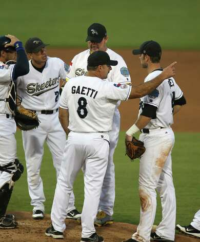 Skeeters manager Gary Gaetti signals to the bullpen for a new pitcher as he takes Roger Clemens out of the game in the fourth inning of the Sugar Land Skeeters baseball game against Bridgeport at Constellation Field, Sunday, Aug. 26, 2012, in Sugar Land, where Roger Clemens was set to take the mound. Photo: Karen Warren, Houston Chronicle / © 2012  Houston Chronicle