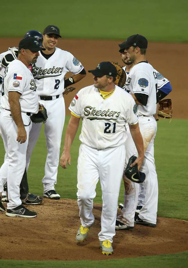 Roger Clemens walks past manager Gary Gaetti as he is taken out of the game in the fourth inning of the Sugar Land Skeeters baseball game against Bridgeport at Constellation Field, Sunday, Aug. 26, 2012, in Sugar Land, where Roger Clemens was set to take the mound. Photo: Karen Warren, Houston Chronicle / © 2012  Houston Chronicle