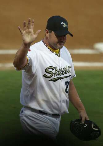 Roger Clemens waves to the crowd as he walks back to the dugout after getting relieved  in the fourth inning of the Sugar Land Skeeters baseball game against Bridgeport at Constellation Field, Sunday, Aug. 26, 2012, in Sugar Land, where Roger Clemens was set to take the mound. Photo: Karen Warren, Houston Chronicle / © 2012  Houston Chronicle