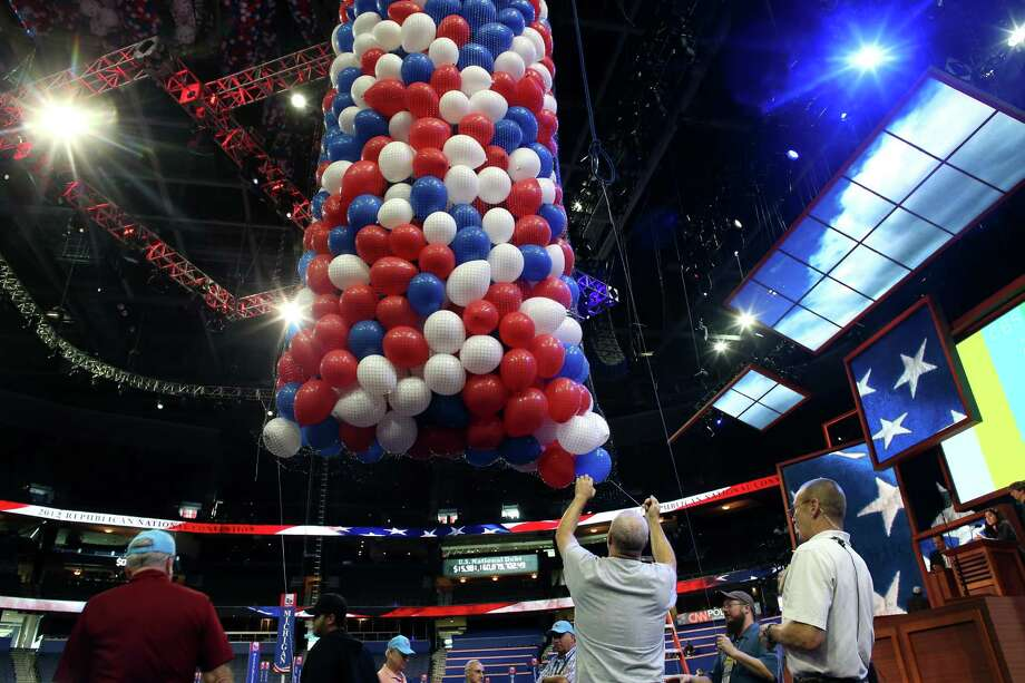 TAMPA, FL - AUGUST 25:  Workers prepare the balloon drop ahead of the Republican National Convention at Tampa Bay Times Forum on August 25, 2012 in Tampa, Florida. Area residents are preparing for Tropical Storm Isaac just before the Republican National Convention which will be held at the Tampa Bay Times Forum during the week of August 27th. The Tropical Storm might become a hurricane by the time it hits ground. Photo: Spencer Platt, Getty Images / 2012 Getty Images
