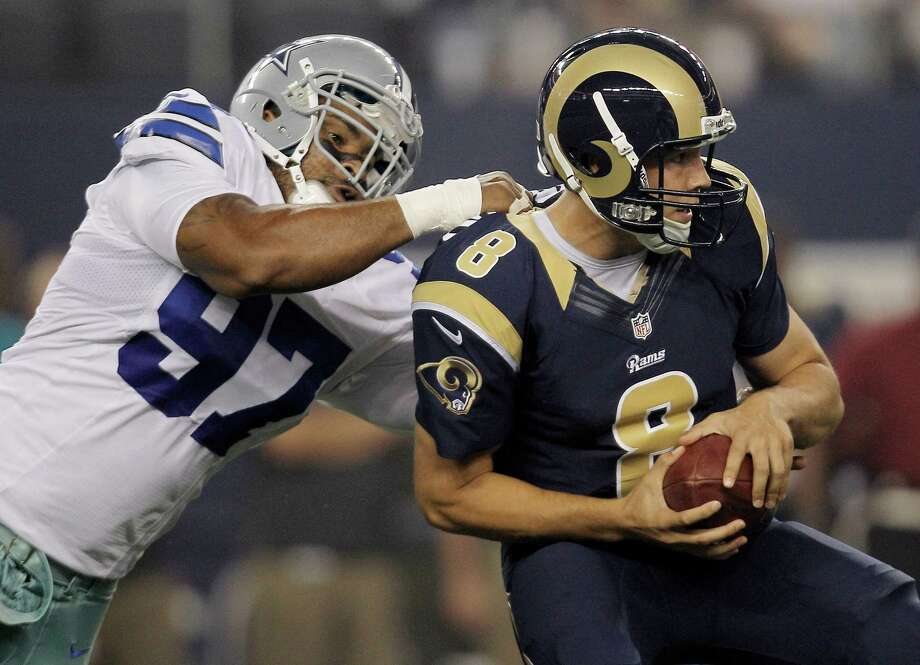 Cowboys defensive end Jason Hatcher (97) sacks Rams quarterback Sam Bradford (8) during a  preseason game, Aug. 25, 2012 at Cowboys Stadium. (AP Photo/Brandon Wade) Photo: Brandon Wade, Associated Press / FR168019 AP