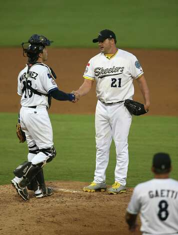 Roger Clemens shakes hands with catcher Octavio Martinez as he waits for manager Gary Gaetti to take him out of the game in the fourth inning of the Sugar Land Skeeters baseball game against Bridgeport at Constellation Field, Sunday, Aug. 26, 2012, in Sugar Land, where Roger Clemens was set to take the mound. Photo: Karen Warren, Houston Chronicle / © 2012  Houston Chronicle