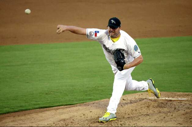 Sugar Land Skeeters pitcher Roger Clemens throws a pitch during a baseball game against the Bridgeport Bluefish Saturday, Aug. 25, 2012, in Sugar Land, Texas. Clemens, a seven-time Cy Young Award winner, signed with the Skeeters of the independent Atlantic League this week. (AP Photo/David J. Phillip) Photo: David Phillip, Associated Press / AP