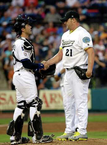 Sugar Land Skeeters Roger Clemens, right, shakes hands with catcher Octavio Martinez, left, as he prepares to leave in the fourth inning of a baseball game against the Bridgeport Bluefish Saturday, Aug. 25, 2012, in Sugar Land, Texas. Clemens, a seven-time Cy Young Award winner, signed with the Skeeters of the independent Atlantic League this week. (AP Photo/David J. Phillip) Photo: David Phillip, Associated Press / AP