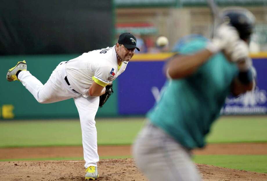 Sugar Land Skeeters Roger Clemens, left, throws a pitch to Bridgeport Bluefish's Luis Rodriguez, right,during a baseball game Saturday, Aug. 25, 2012, in Sugar Land, Texas. Clemens, a seven-time Cy Young Award winner, signed with the Skeeters of the independent Atlantic League this week. (AP Photo/David J. Phillip) Photo: David Phillip, Associated Press / AP
