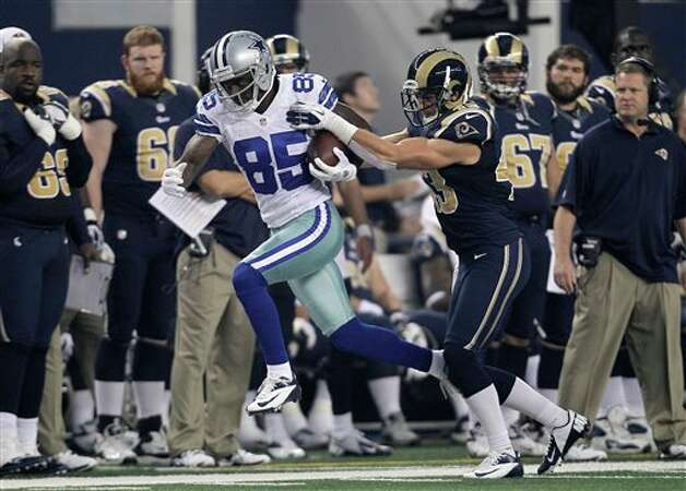 Dallas Cowboys wide receiver Kevin Ogletree (85) attempts to evade a tackle by St. Louis Rams' Chris Givens (13) during a preseason NFL football game Saturday, Aug. 25, 2012, in Arlington, Texas. (AP Photo/LM Otero) Photo: LM Otero, Associated Press / AP